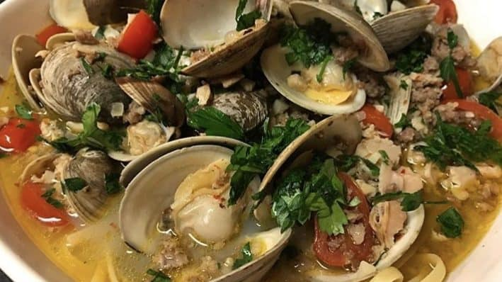 a bowl of linguine with clam sauce