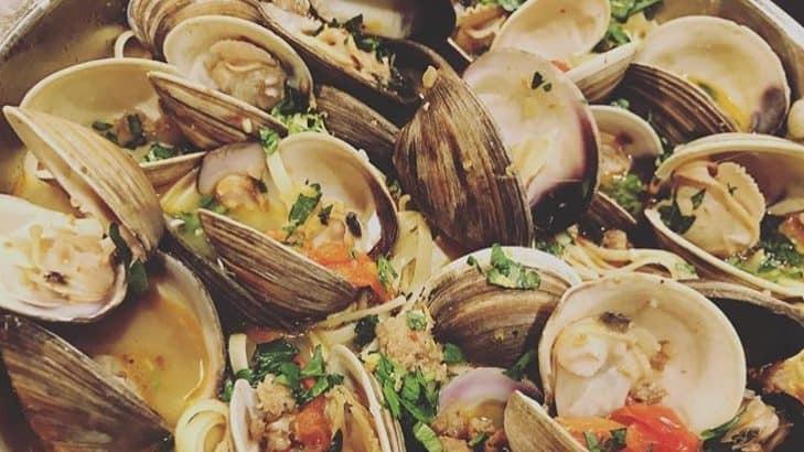 a bowl of clams in a sambuca cream sauce