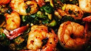 a bowl of spicy honey shrimp with Brussels sprouts