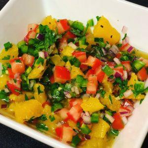 a bowl of citrus jalapeño salsa