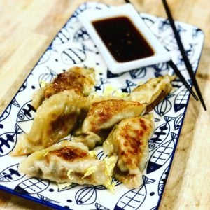 a plate of shrimp and pork gyoza