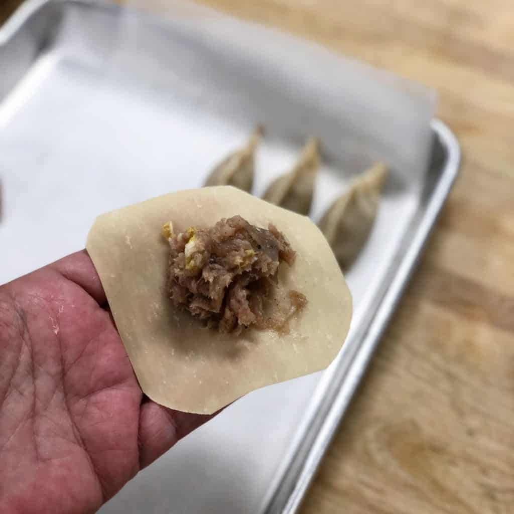 filling shrimp and pork gyozas