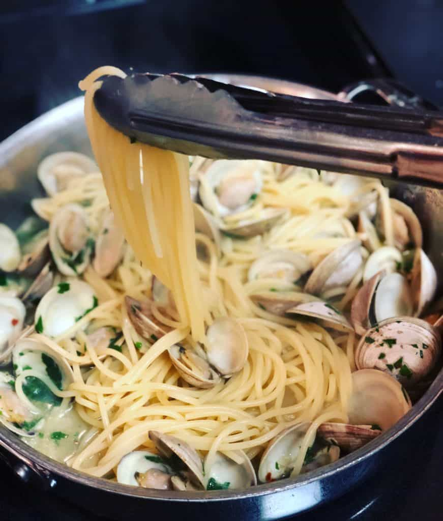 a pot of spaghetti with clams