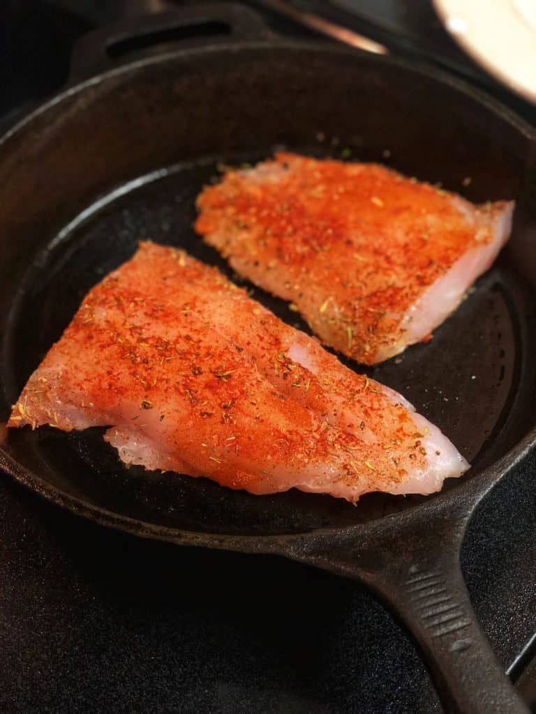 two filets of blackened grouper