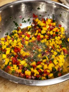 a stainless steel bowl of mango salsa