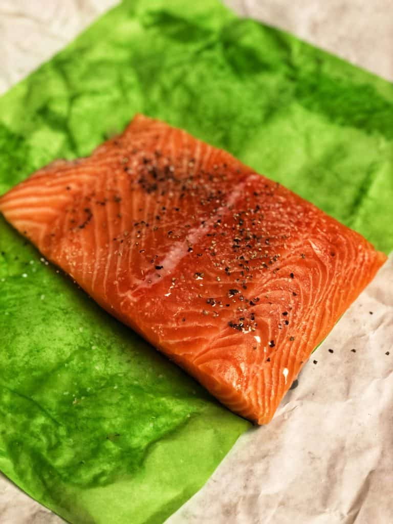 a filet of salmon on a green paper