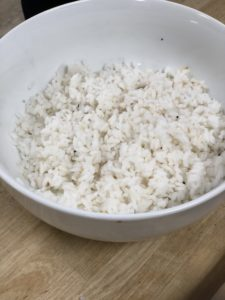 a white bowl of sushi rice