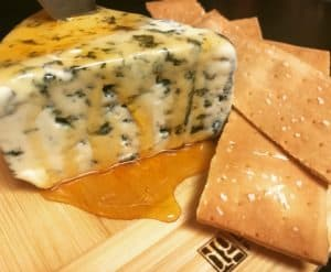 a block of blue cheese covered in honey for a charcuterie and cheese board