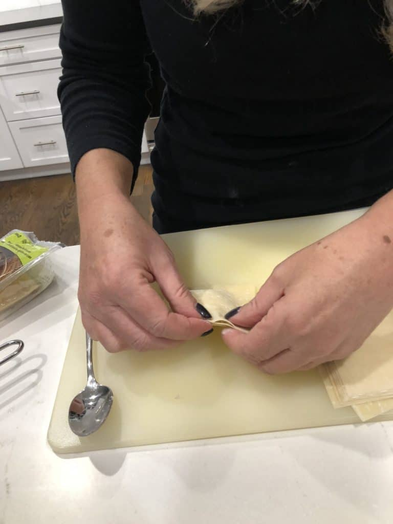 sealing edges of wonton wrappers
