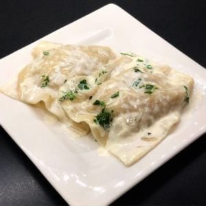 crab ravioli on a white plate