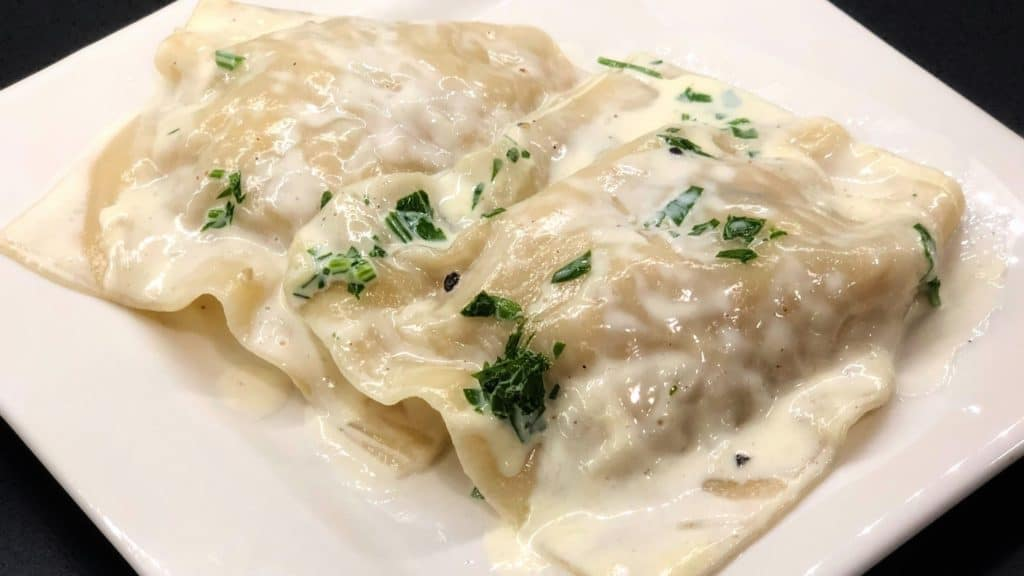 two pieces of crab ravioli