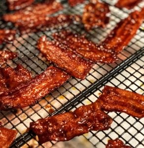 candied bacon drying on a cooling rack