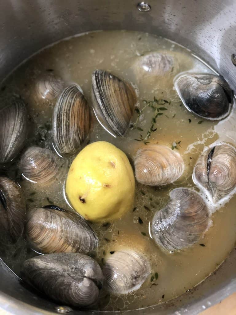 making clam broth in a pot