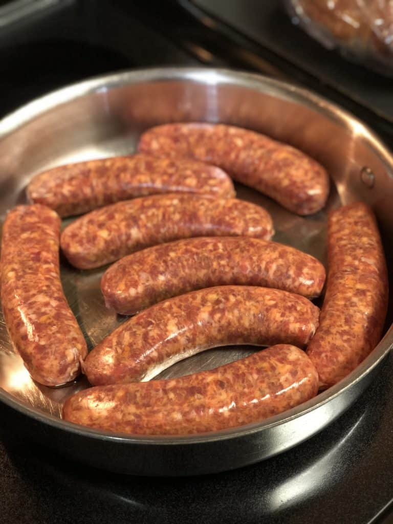 hot sausage links in a pan