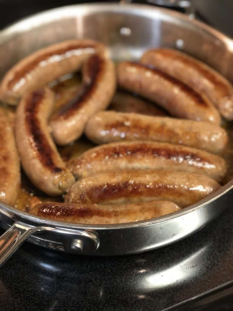 sausage links browning in a pan