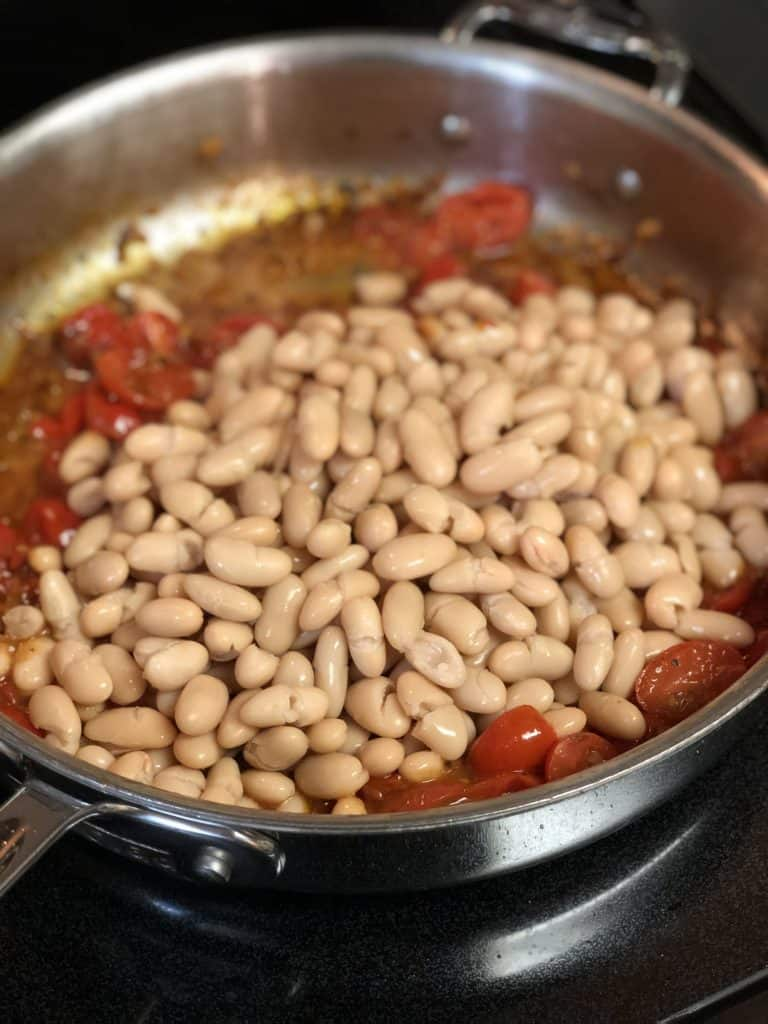 beans in a pan for Italian sausage and beans