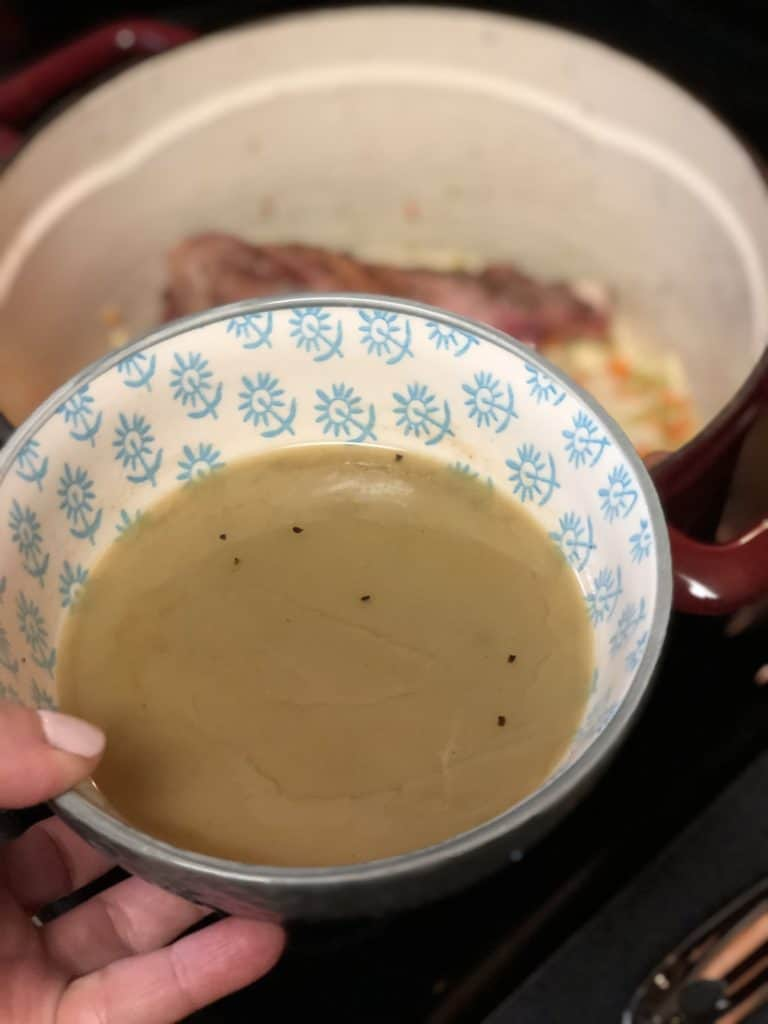 a bowl of wine broth