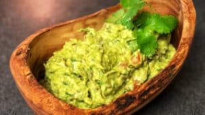 guacamole in a wooden bowl