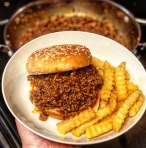 sloppy joe and fries in a white bowl