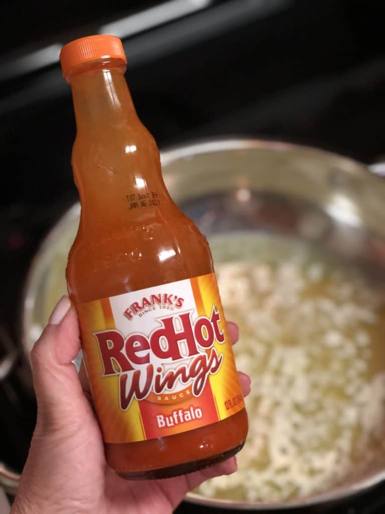 a bottle of red hot sauce