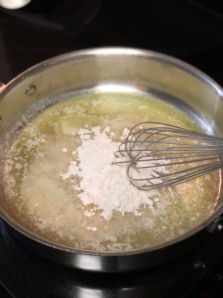 whisking butter and flour in a pan