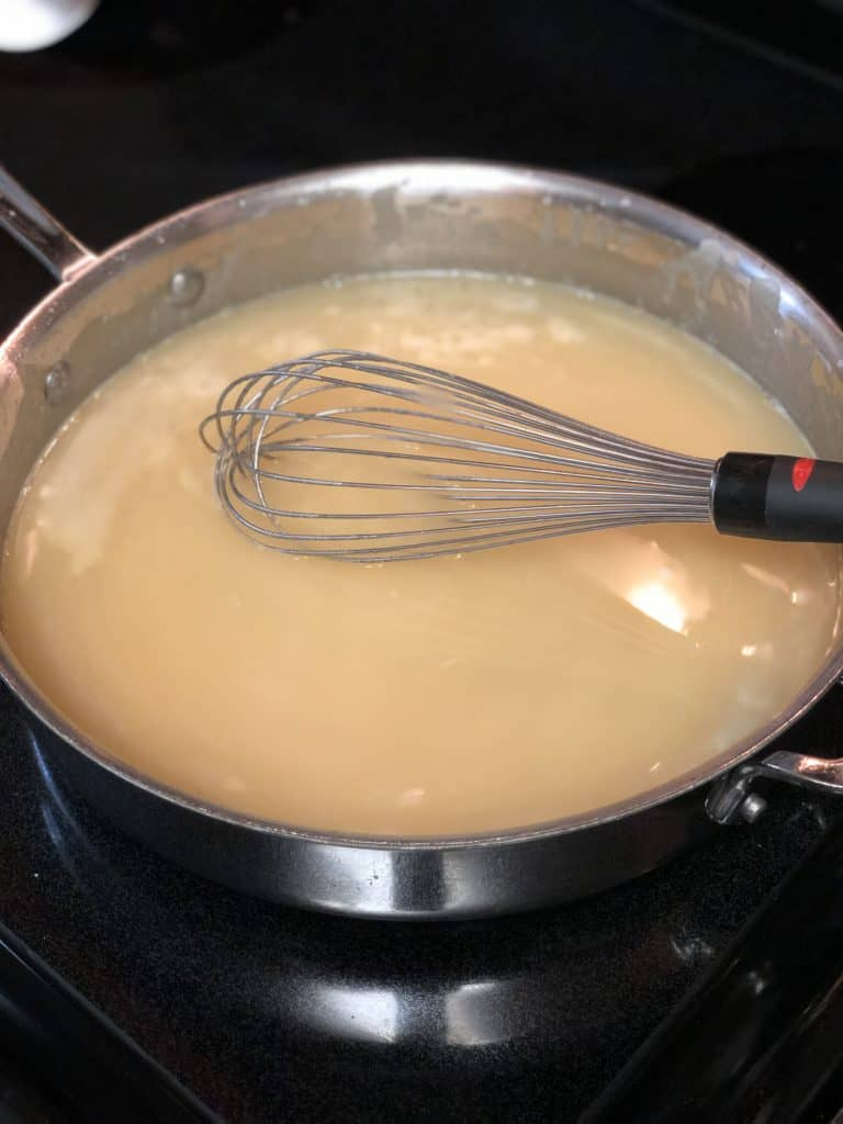 whisking sauce for chicken enchiladas