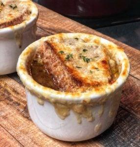 a white bowl of french onion soup