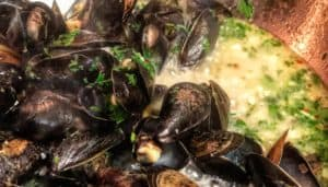 a pot of steamed mussels in white wine and garlic