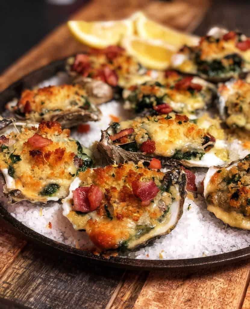 a plate of oysters Rockefeller on salt