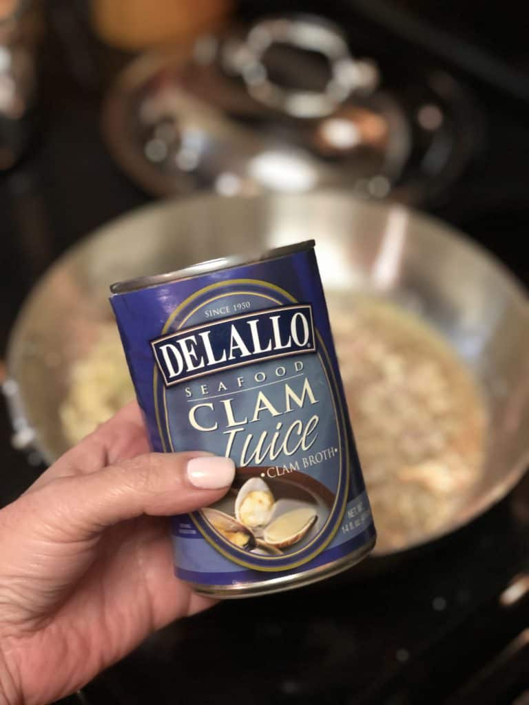 a can of Delallo clam juice