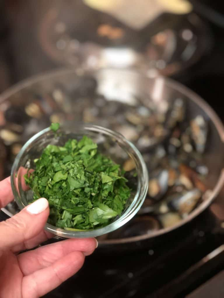 a small glass bowl of fresh chopped parsley