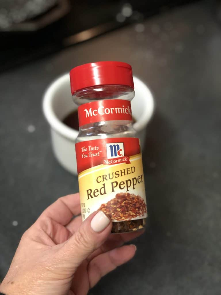 a jar of McCormick crushed red pepper flakes
