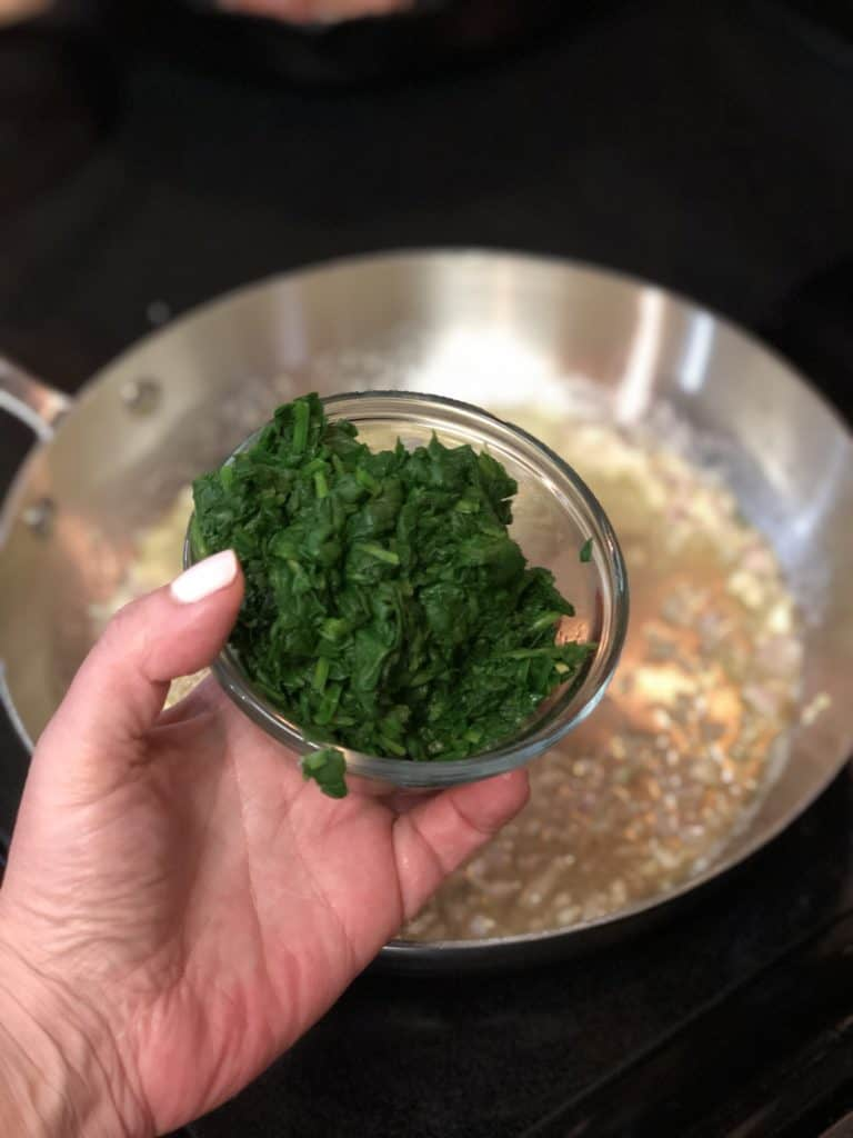 a glass bowl of spinach