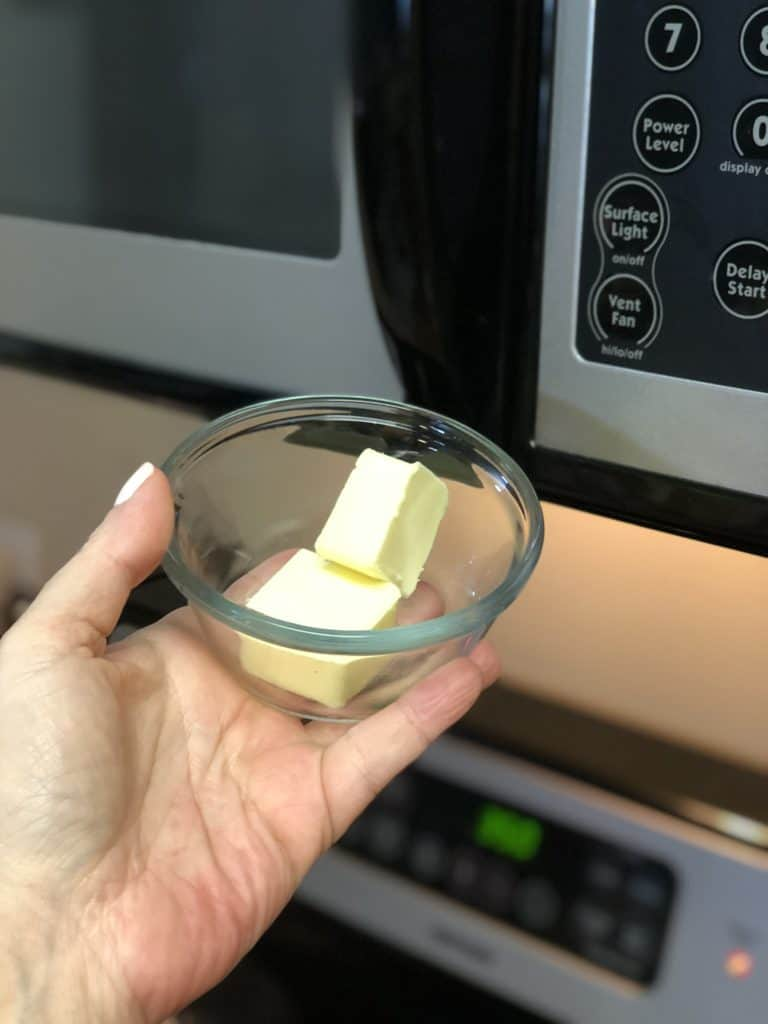 a glass bowl of butter