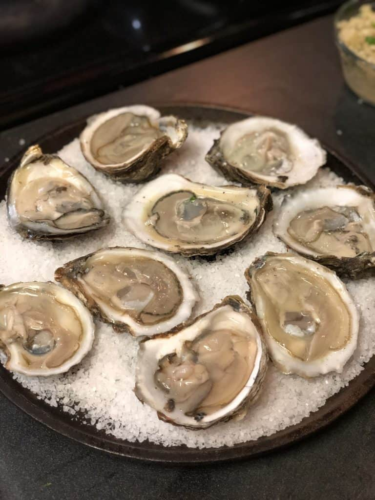 raw oysters on a bed of salt