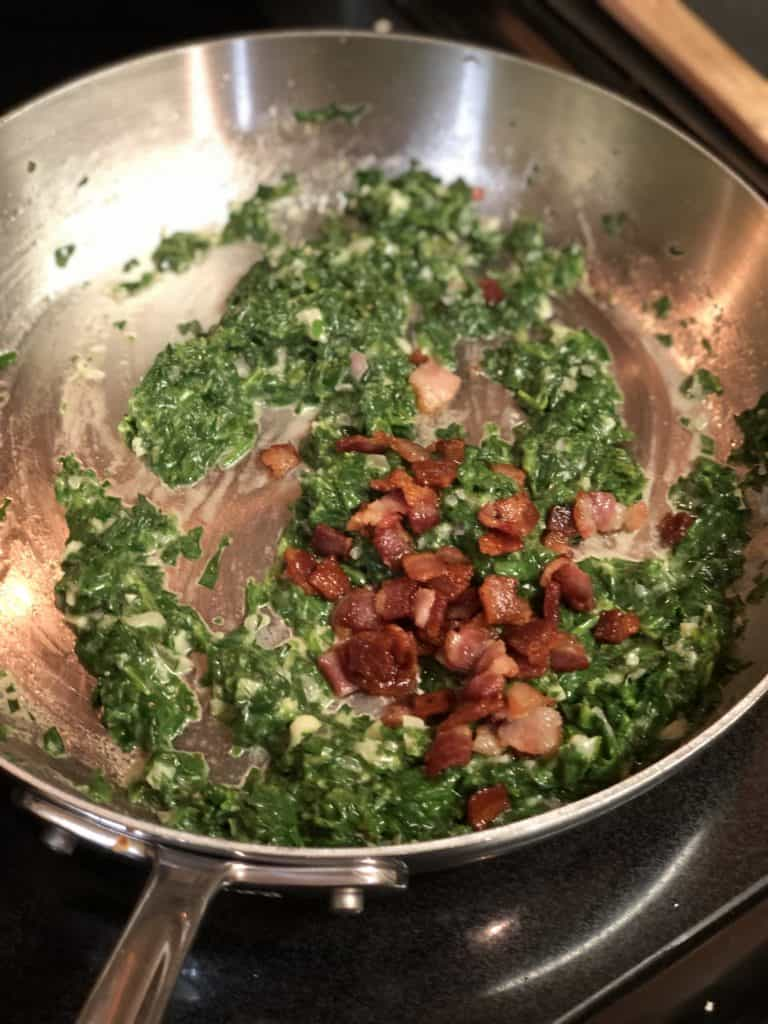 spinach and bacon mixture in a pan for Oysters Rockefeller