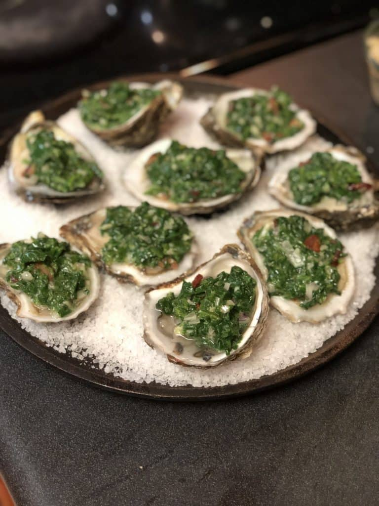 raw oysters filled with spinach mixture
