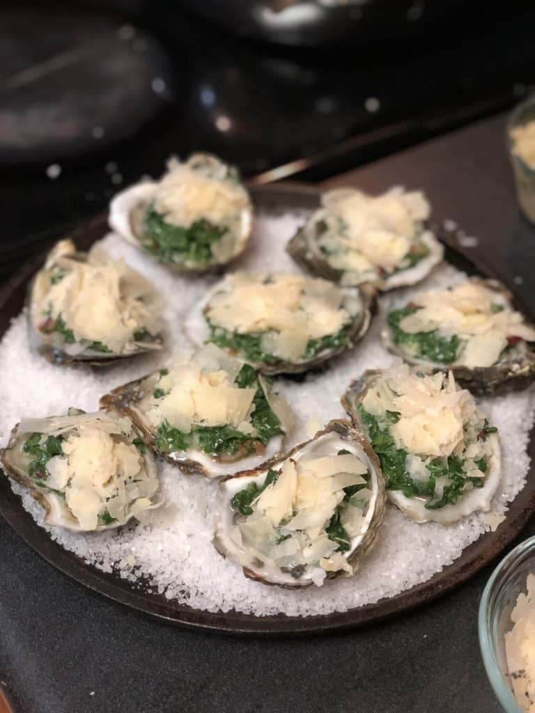 raw oysters topped with cheese