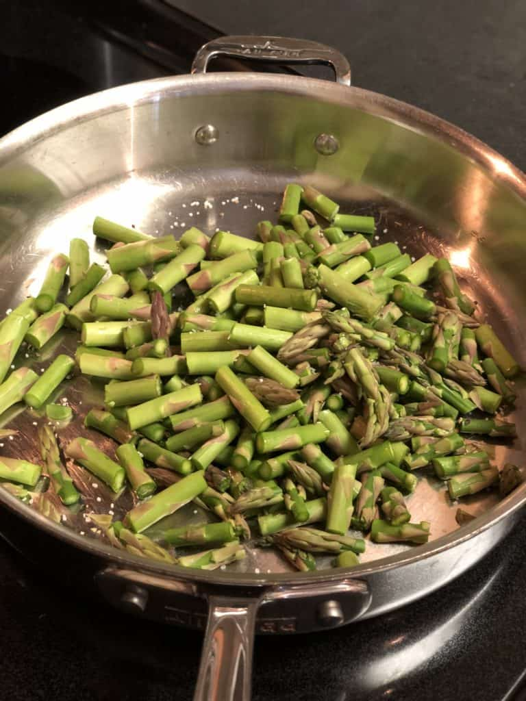 asparagus tips browning in a pan for my linguine with seared scallops