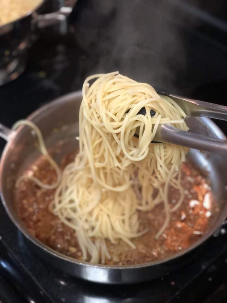 spaghetti on tongs