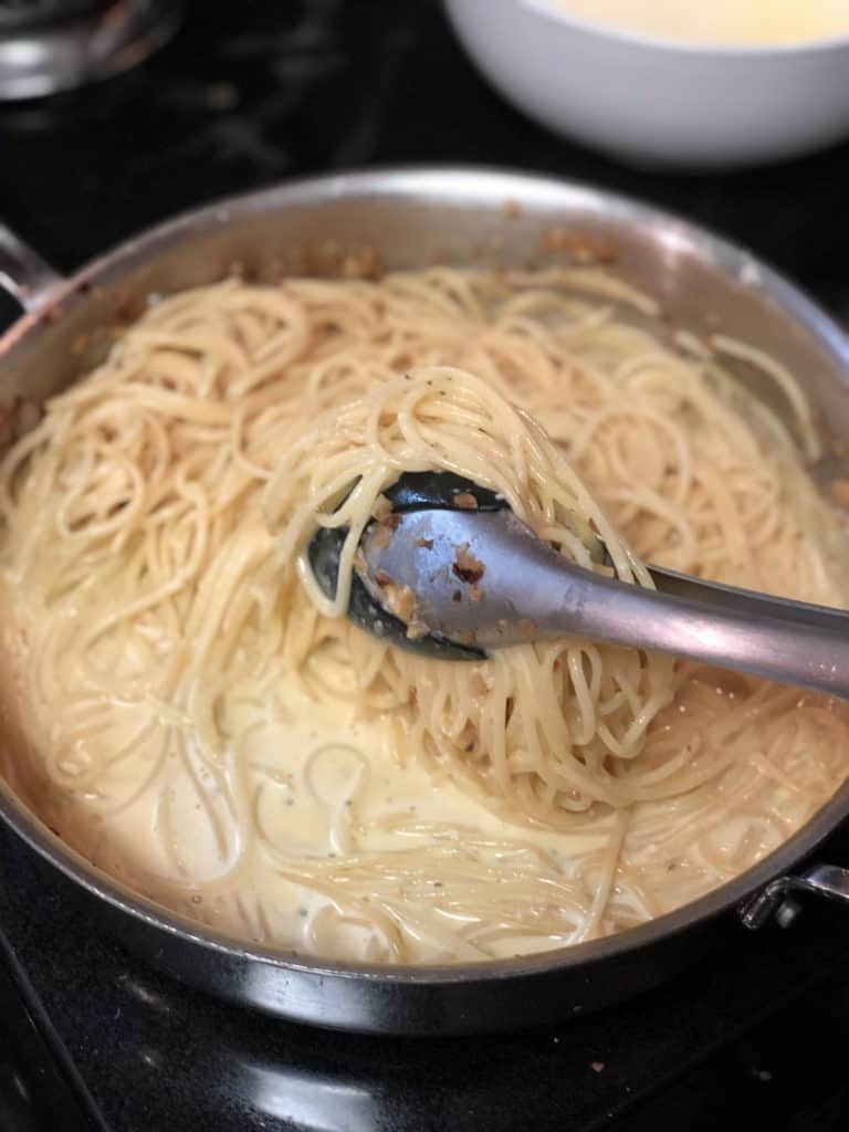 spaghetti in a pan with egg mixture
