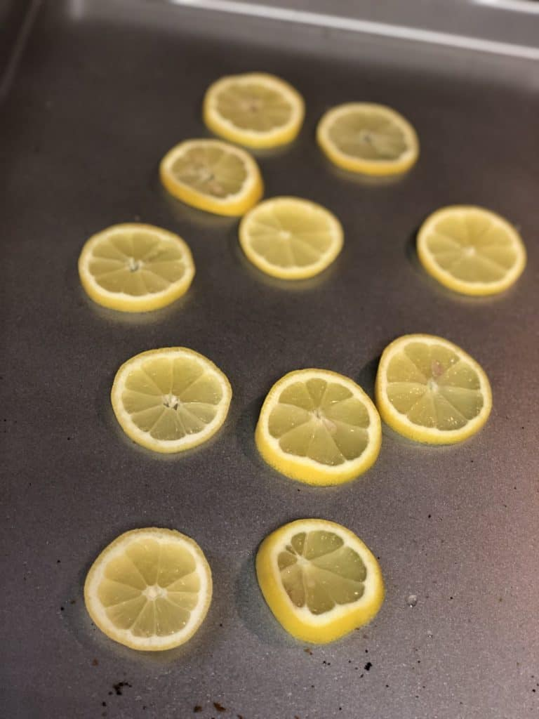 lemon slices on a wooden board
