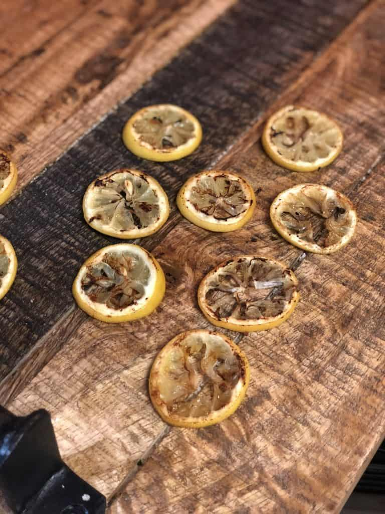 fried lemon slices on a wooden board
