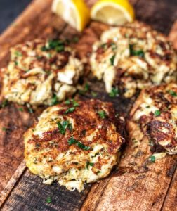 crab cakes on a wooden board