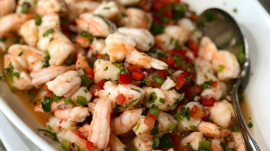 a white bowl of ceviche