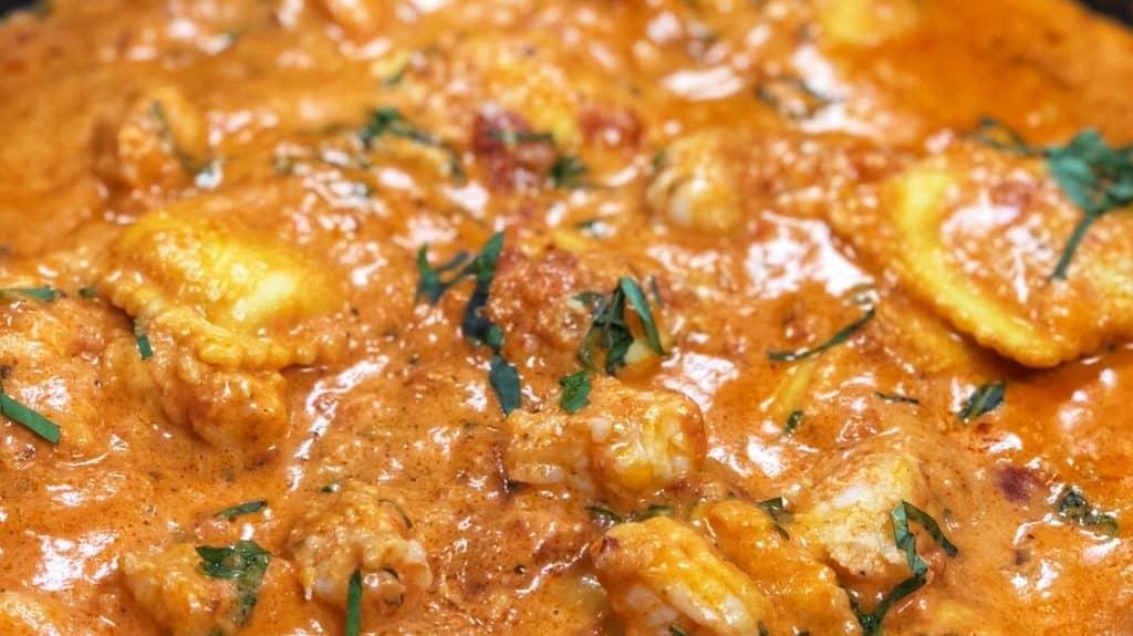 a pan of ravioli with shrimp