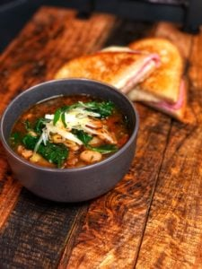 Minestrone soup with a Gruyere and Ham grilled cheese