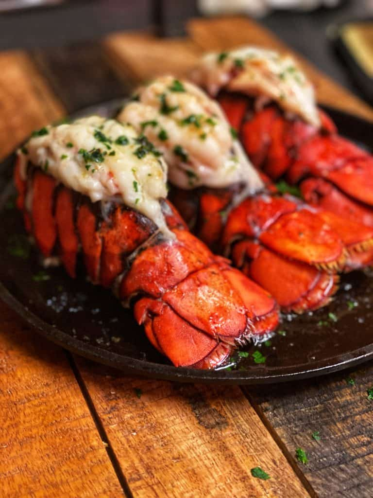 three broiled lobster tails