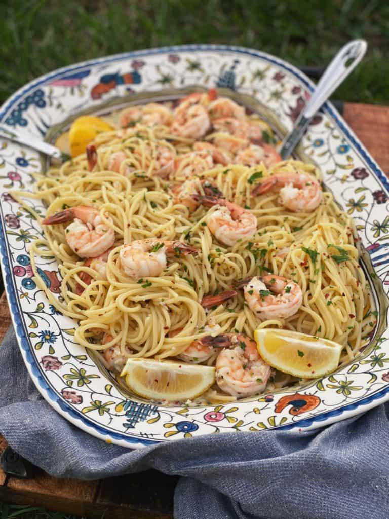an ornamental platter of shrimp scampi pasta