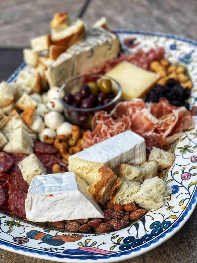 charcuterie and cheese displayed on a platter